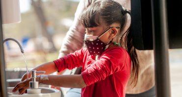 iLEAD Agua Dulce learner washes hands